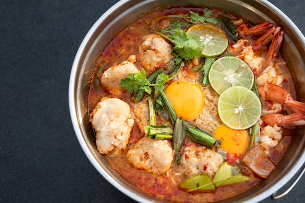 Tom yum goong soup fire pot traditional asian food from thailand