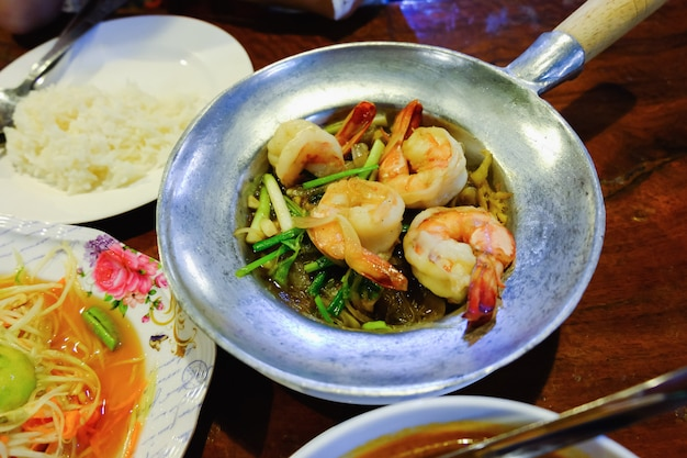 Tom yum goong on wood table, thai food