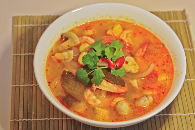 Tom yum kung - hot spicy sour thai herbal soup with prawn