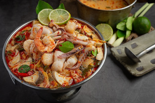 Tom yum mixed seafood in thick soup hot pot spicy thai food.