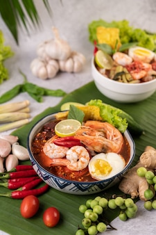Tom yum noodles with shrimp and boiled eggs.