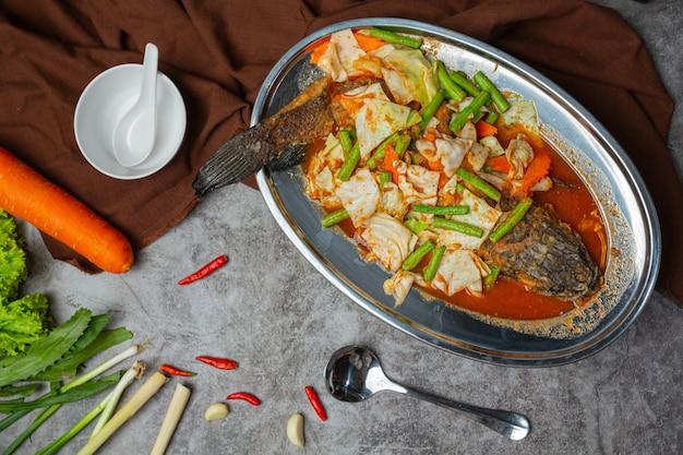 Tom yum snakehead fish hot pot thai food.