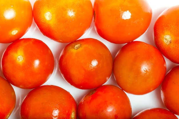 Tomato cherry isolated on white background. top view. macro photography.