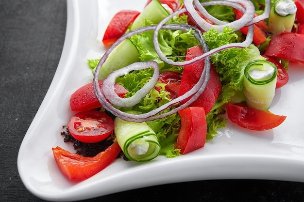 Tomato cherry salad with basil black pepper and onion