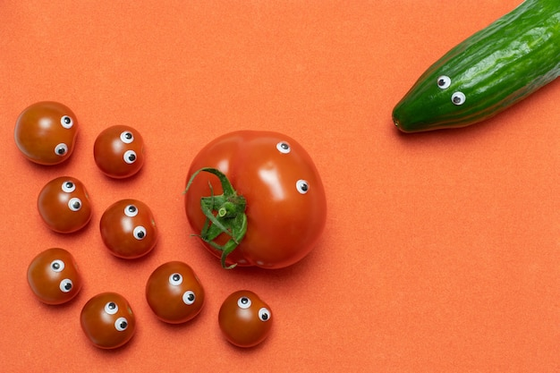Tomato and cucumber concept, copy space. live fresh cherry tomatoes