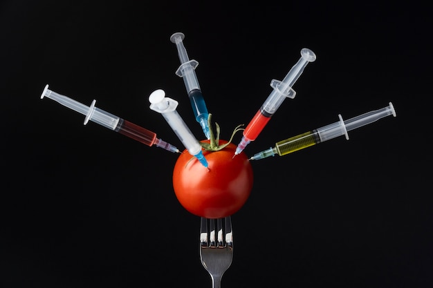 Tomato filled with syringes