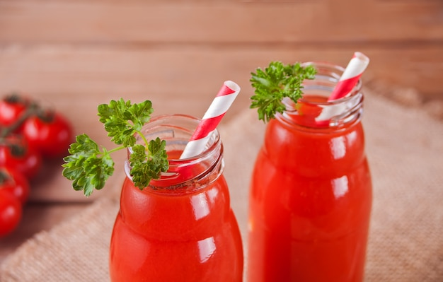 Tomato juice with parsley and salt on woo
