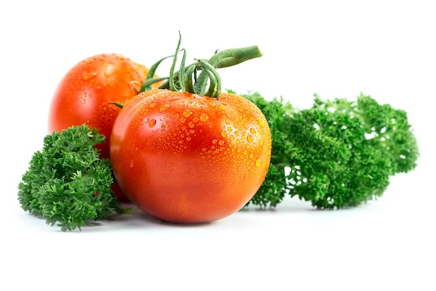 Tomato and parsley with drop isolated on white