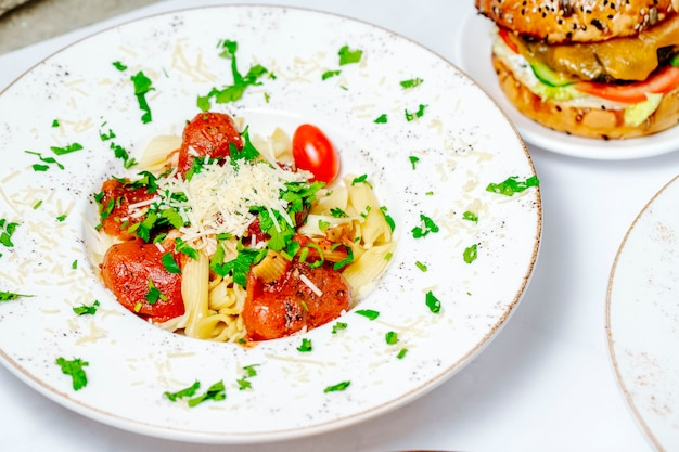 Tomato pasta topped with herbs and cheese