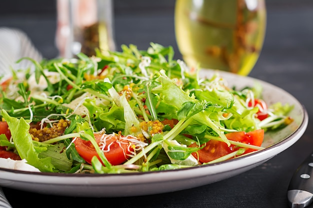 Tomato salad with mix micro greens and  camembert cheese.