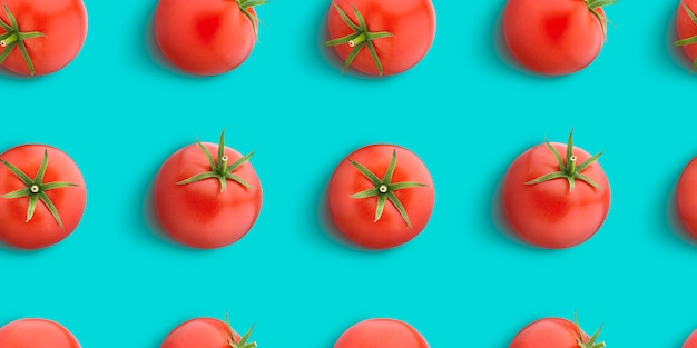 Tomato seamless pattern isolated on blue surface, flat lay, top view