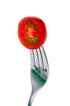 Tomato slice skewered on fork
