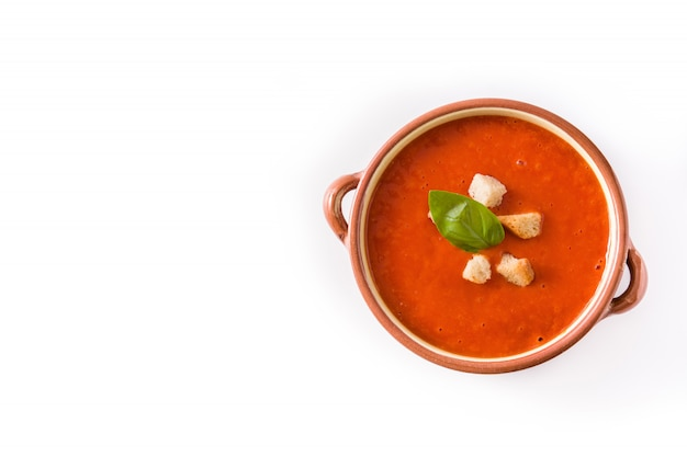 Tomato soup in brown bowl isolated on white