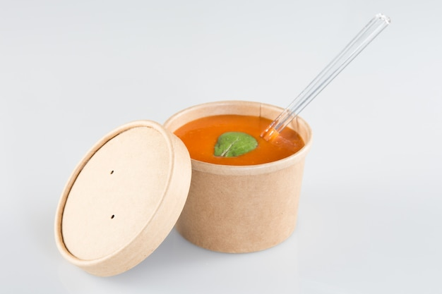 Tomato soup gazpacho on carton box takeaway