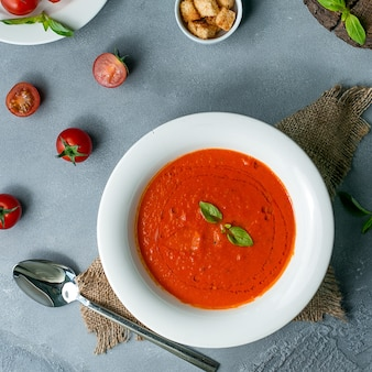 Tomato soup on the table top view
