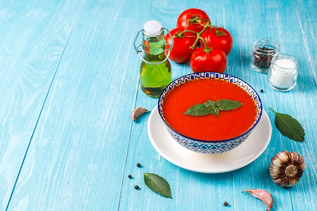 Tomato soup with basil in a bowl.