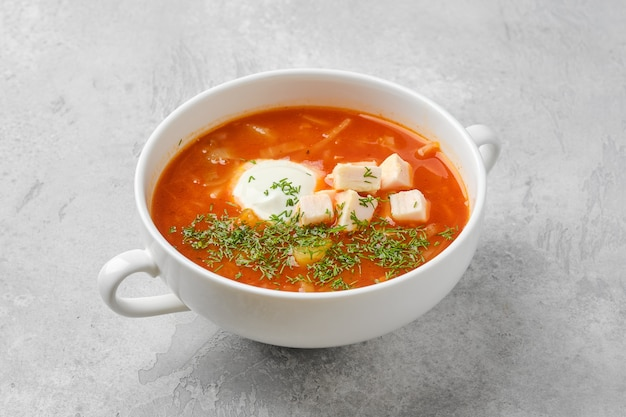 Tomato soup with chicken meat and sour cream