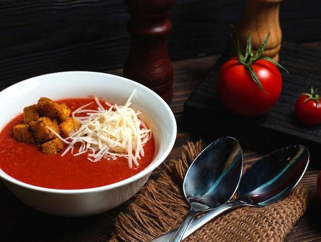 Tomato soup with grated cheese and breadcrumbs