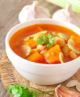 Tomato soup with pumpkin, beans and celery