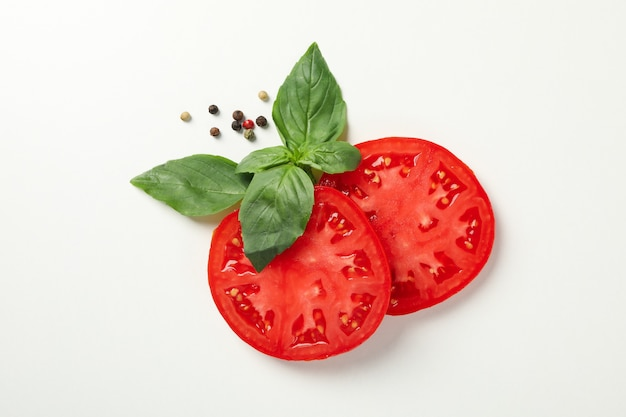 Tomato and spices on white background, top view