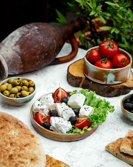 Tomato and white cheese salad with olives