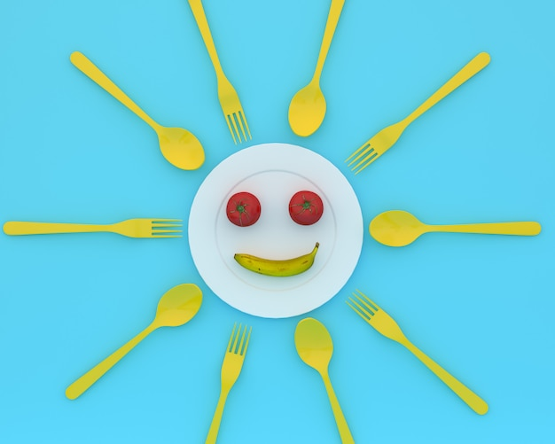 Tomatoes and banana is smile put on the plate with spoons and forks on blue color. minimal