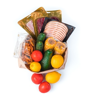 Tomatoes, cucumbers, corn, sausage and tomato crackers in a paper bag