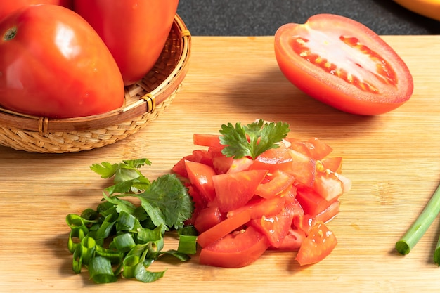 Tomatoes cut into small cubes green onions and salsa ingredients preparation