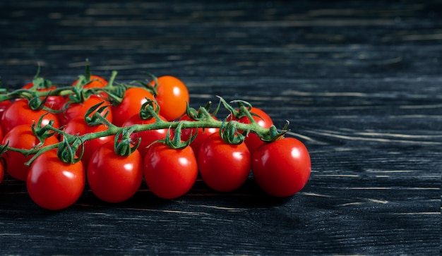 Tomatoes on a dark black wooden table
