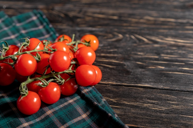 Tomatoes on a dark wooden table