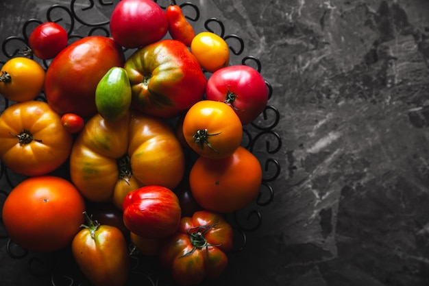 Tomatoes on a gray table, healthy food, vegetables