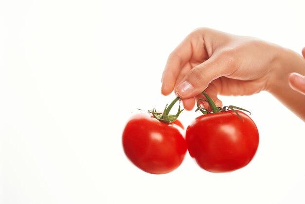 Tomatoes in hand cooking kitchen salad ingredients vitamins