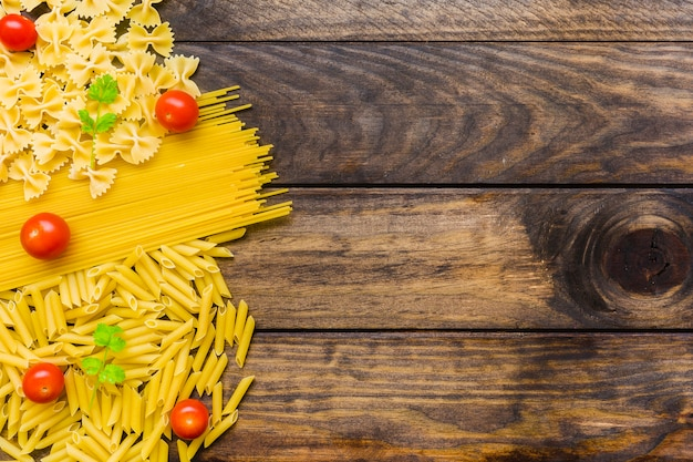 Tomatoes and herbs on pasta