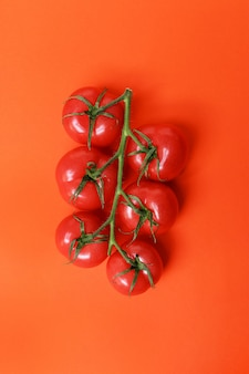 Tomatoes isolated on red surface