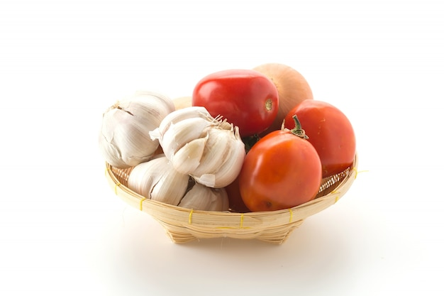 Tomatoes, onion and garlic in basket