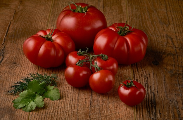 Tomatoes on rustic wooden background