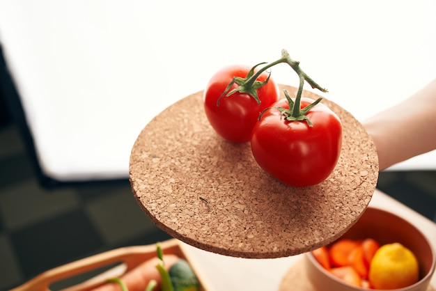Tomatoes on a vegetable branch cooking organic. high quality photo