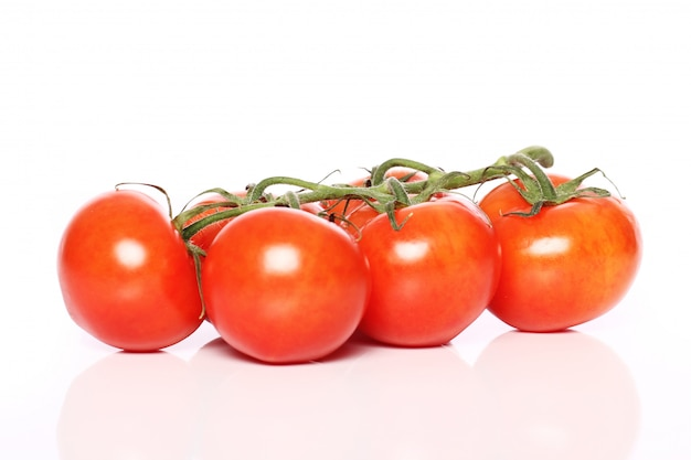 Tomatoes over white surface