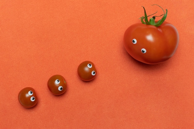 Tomatoes with eyes funny concept, copy space