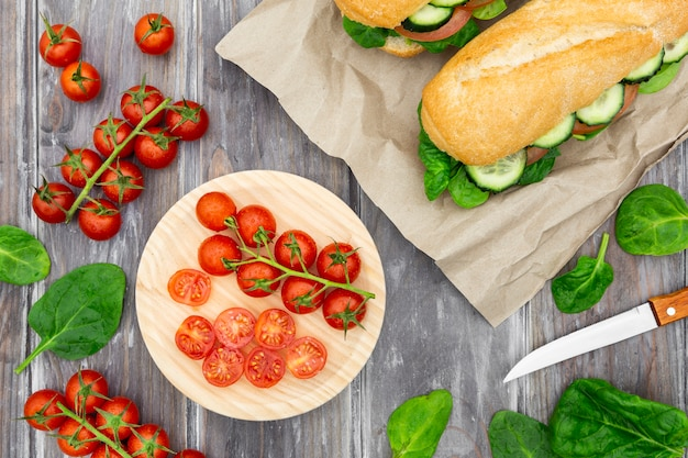 Tomatoes with spinach and sandwich