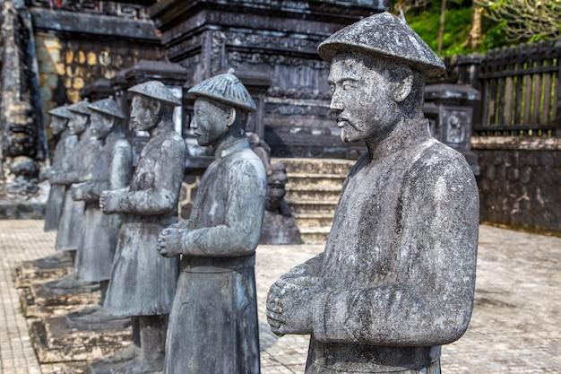 Tomb of khai dinh with manadarin honour guard in hue in vietnam