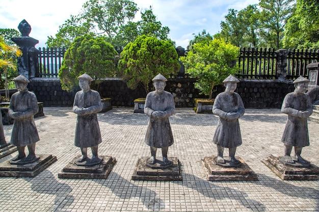 Tomb of khai dinh with manadarin honour guard in hue, vietnam