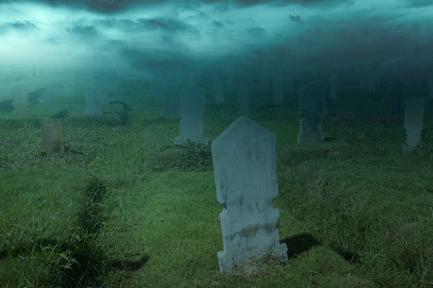 Tombstones on the graveyard with night scene background. halloween concept