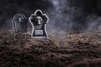 Tombstones on night cemetery in fog