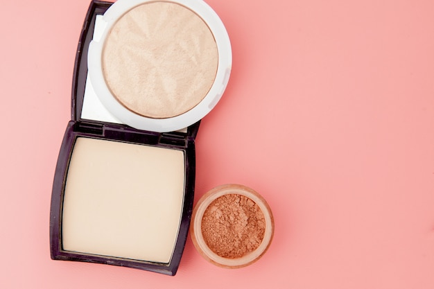 Tonal foundation and highlighter, base for make-up in the form of a cushion. highlighter powder cosmetic product top view