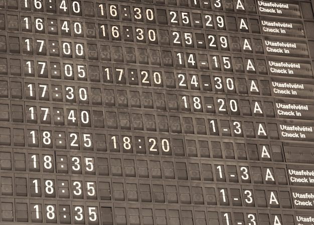 Toned detail view of a typical airport information board