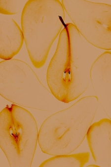 Toned image of close up texture of backlit illuminated pear slices autumn food concept background