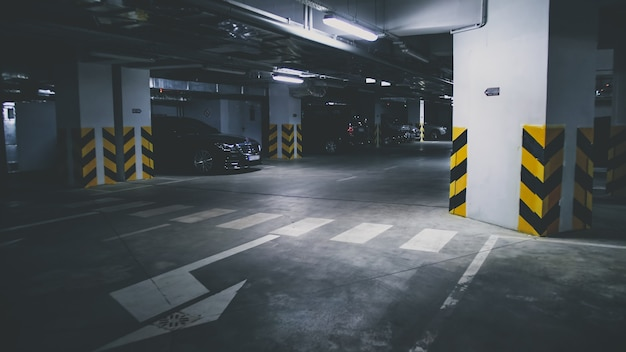 Toned image of underground car parking at office building basement