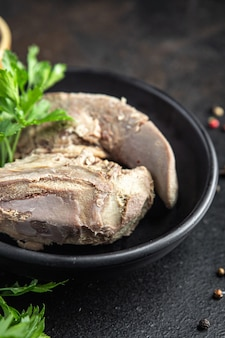 Tongue pork cooked meat boiled fresh meal snack on the table copy space food background rustic
