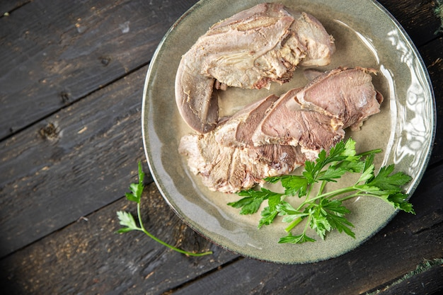 Tongue pork meat in plate on the table cooked fresh meal snack copy space food background rustic